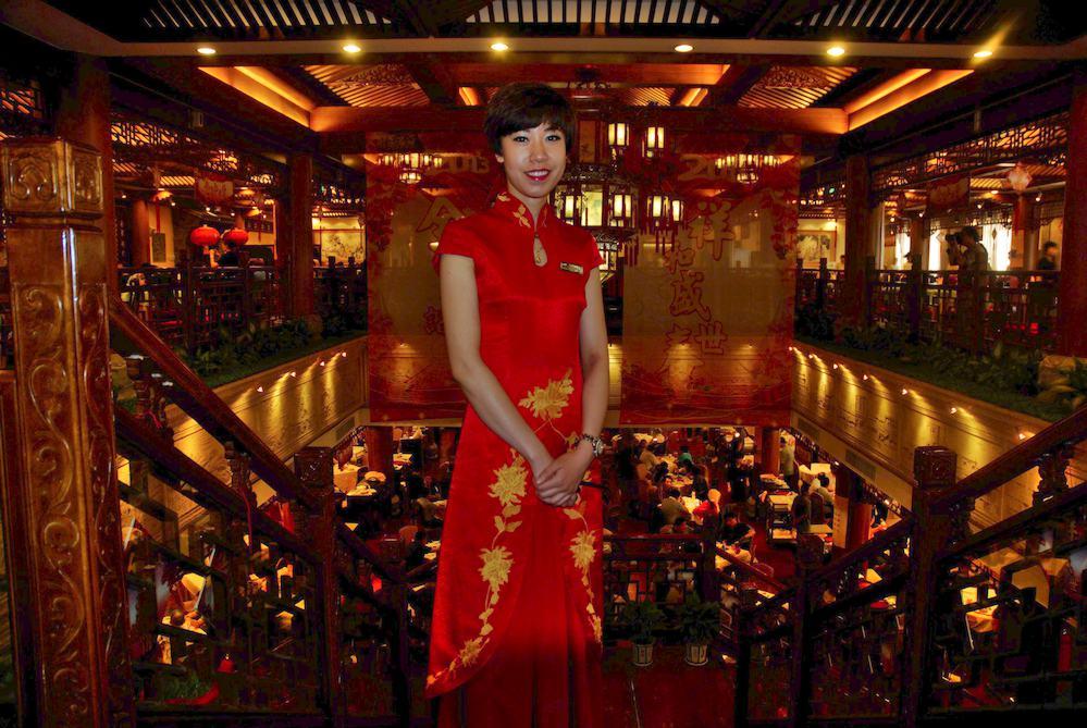 7-Encargada de un restaurante tradicional de Pato Laqueado en el centro de Pekín